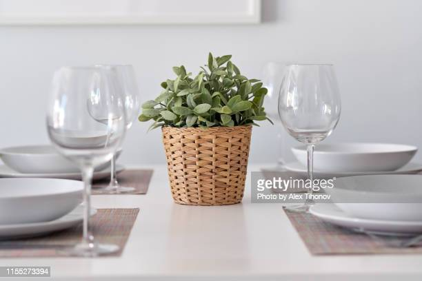 table arrangement with empty clean wine glasses white bowls and plates on place mat - arranging stock pictures, royalty-free photos & images