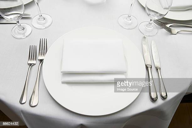 a table at a restaurant - napkin stock pictures, royalty-free photos & images