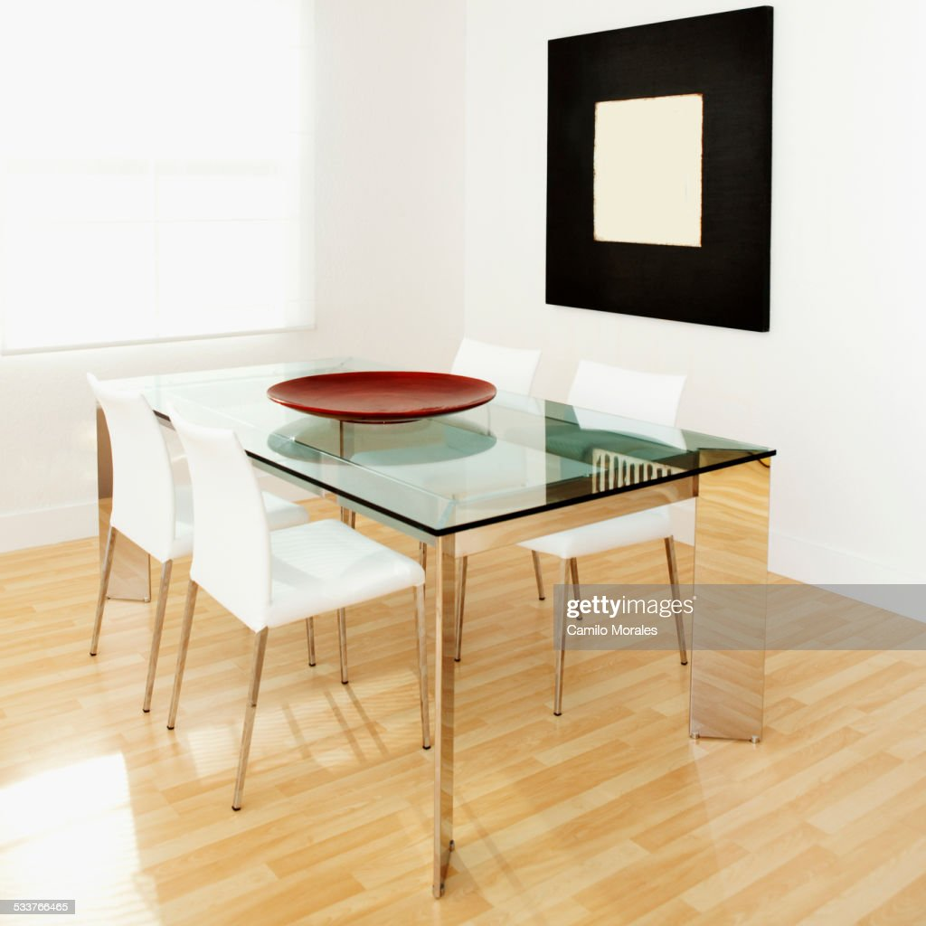 Table, chairs and wall art in modern dining room : Foto stock