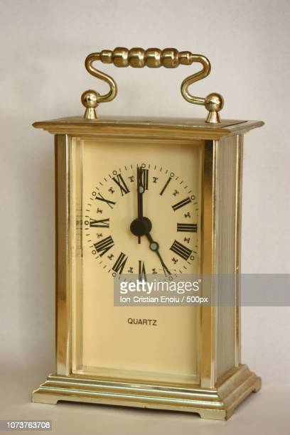 Table clock showing 5 o'clock.