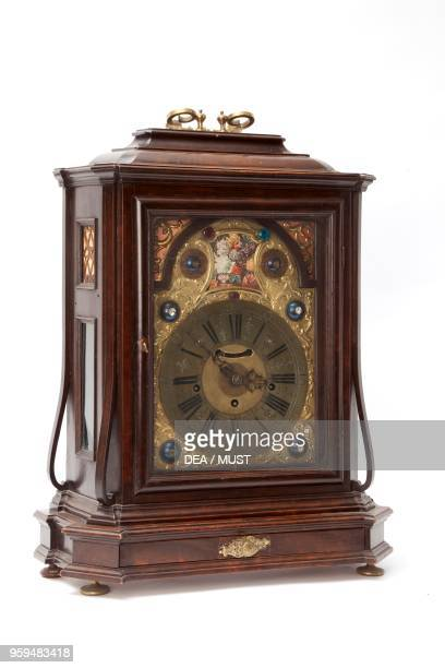 Table clock with wooden case and bronze dial signed by Giuseppe Dominici Trento Italy 18th century