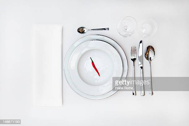 table cover with a red pepper on the upper plate - silverware stock pictures, royalty-free photos & images