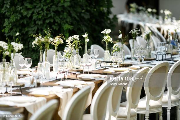 table decorations in white on rustic wedding - stock photo - cérémonie photos et images de collection