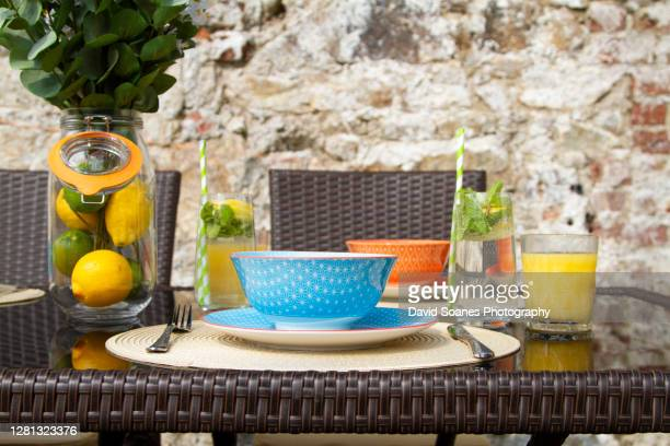 table decorations on an outdoor table presentation - david soanes stock pictures, royalty-free photos & images
