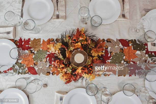 table festively decorated for autumn holidays - thanksgiving decoration stock pictures, royalty-free photos & images