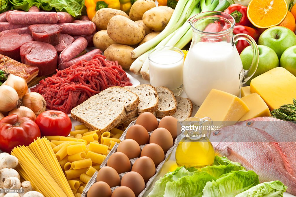 Table filled with different types of foods : Stock Photo