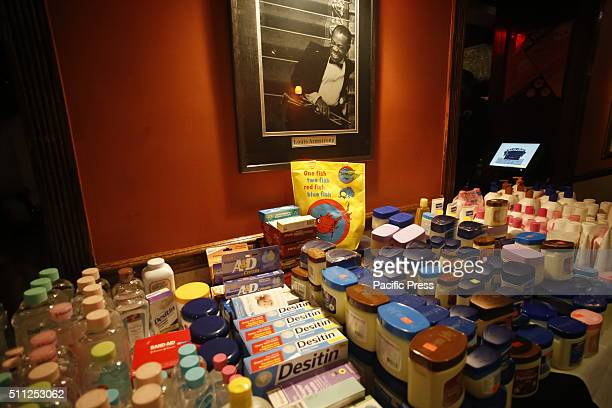 Table filled with supplies at Sylvia's underneath picture of Louis Armstrong NYC first lady Chirlane McCray joined business and community leaders at...