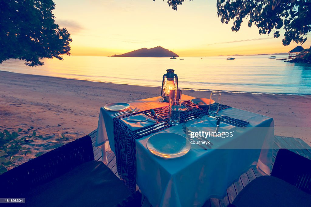 Table for two on the beach : Stock Photo