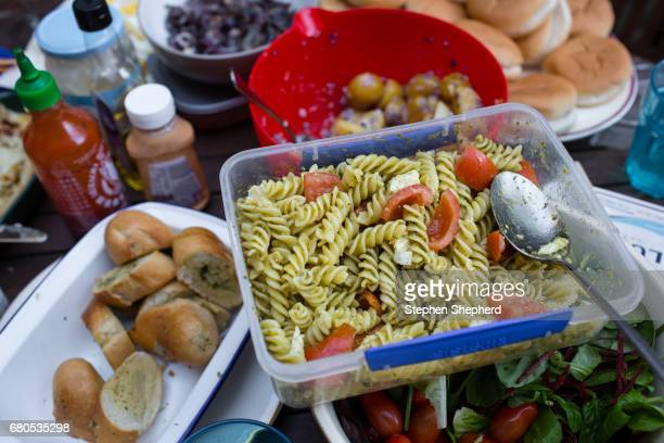 a table full of barbecue meat and salads. - cirencester stock pictures, royalty-free photos & images