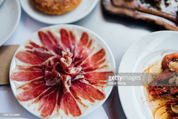 a table full of spanish food - spanish culture stock pictures, royalty-free photos & images