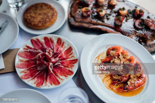 a table full of spanish food - barcelona spain stock pictures, royalty-free photos & images