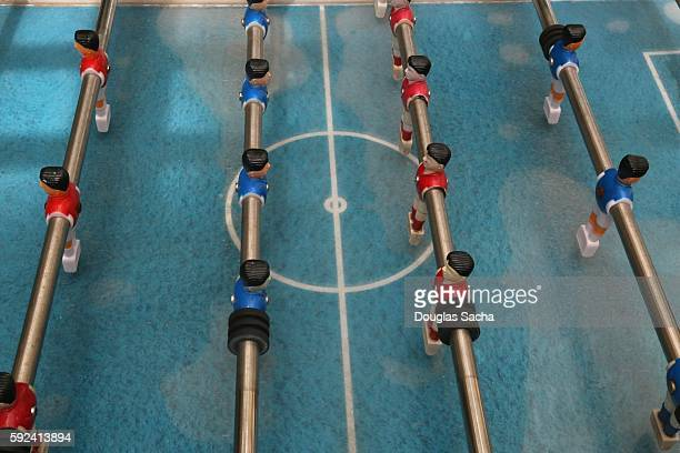Table game board with moving foosball figurines