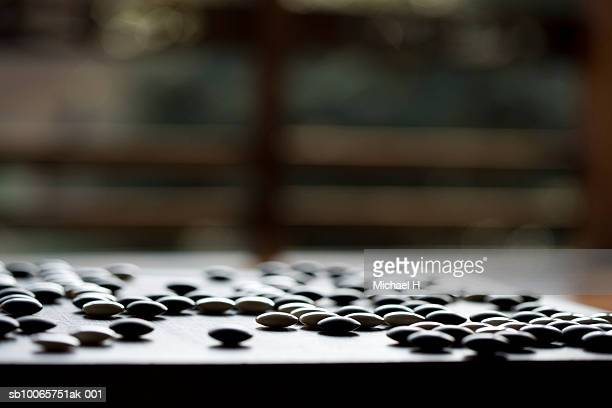 Table game of Go, close up of Go stones