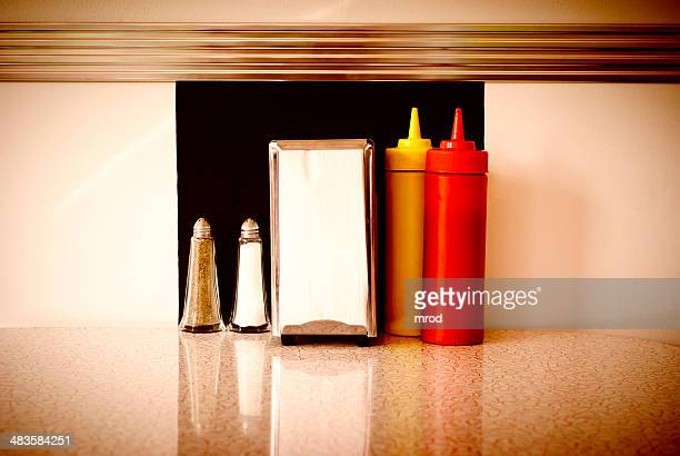 table in a diner - diner stock pictures, royalty-free photos & images