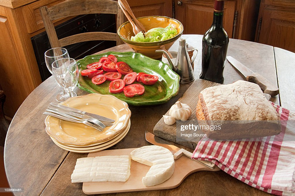Table in french country kitchen : Stock Photo