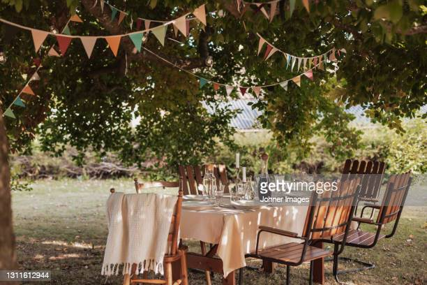table in garden set for meal - garden party stock pictures, royalty-free photos & images
