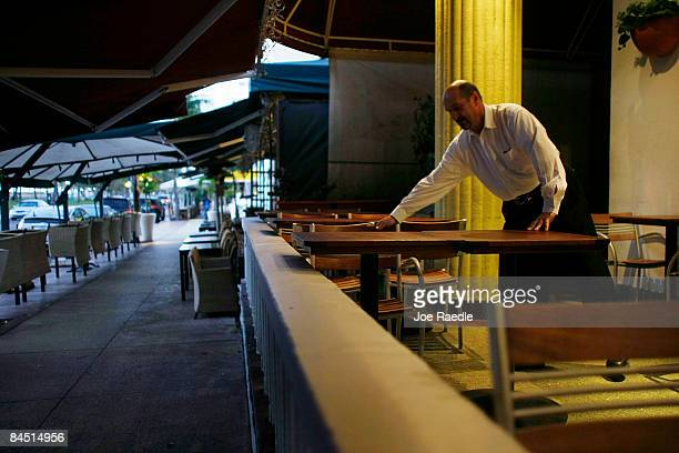 A table is prepared for breakfast at a hotel on the famed Ocean Drive strip on January 28 2009 in Miami Beach Florida As the economic downturn...