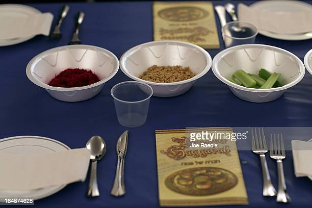 A table is set for a community Passover Seder at Beth Israel synagogue on March 25 2013 in Miami Beach Florida The community Passover Seder that...