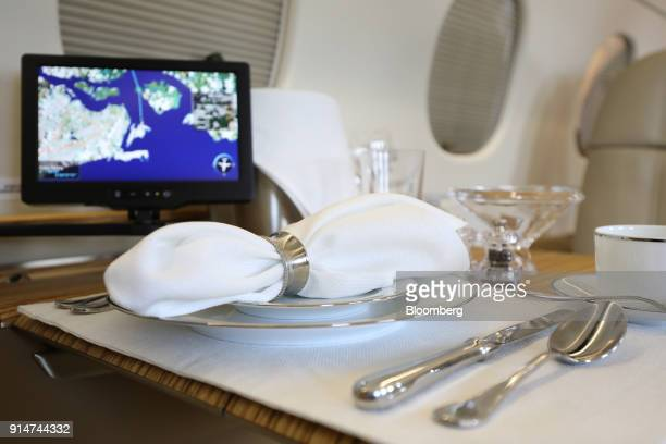 A table is set for dining aboard an Embraer SA Legacy 500 jet during the Singapore Airshow held at the Changi Exhibition Centre in Singapore on...