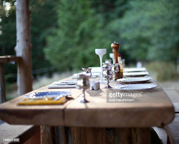 A table is set for dinner on a patio