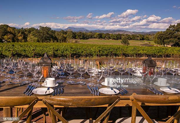 A table is set with hundreds of wine glasses for a visiting group of tourists attending a Russian River Valley Wine Country dinner on September 25...