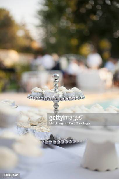 a table laid for a banquet or a wedding breakfast. white table cloth, cake stand, and table setting.  - utah wedding stock pictures, royalty-free photos & images