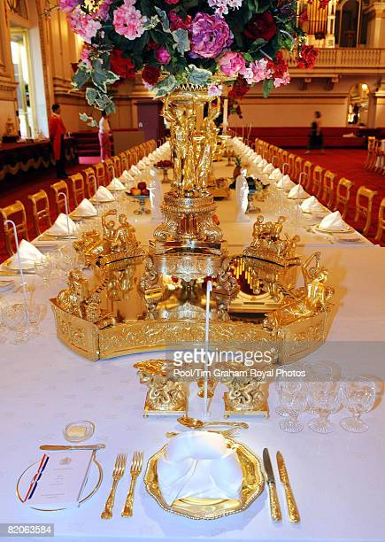 Table laid with the silver-gilt Grand Service for a State Banquet, part of the Summer Opening exhibition at Buckingham Palace, on July 25, 2008 in...