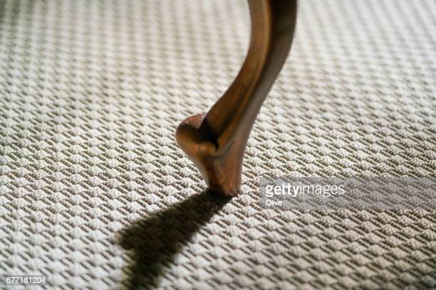 table leg and its shadow on floor