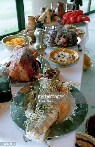 A table loaded with food for the Thanksgiving feast served up at Plimoth Plantation includes fricase of cod goose with a Ppudding roasted venison...