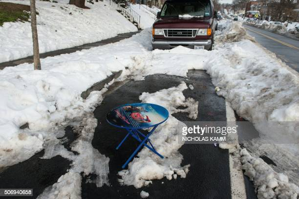 A table marks a dug out parking spot on a street in Washington DC on January 26 three days after a massive snowstorm The capital of the world's...