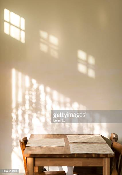Table next to wall with shadow and light