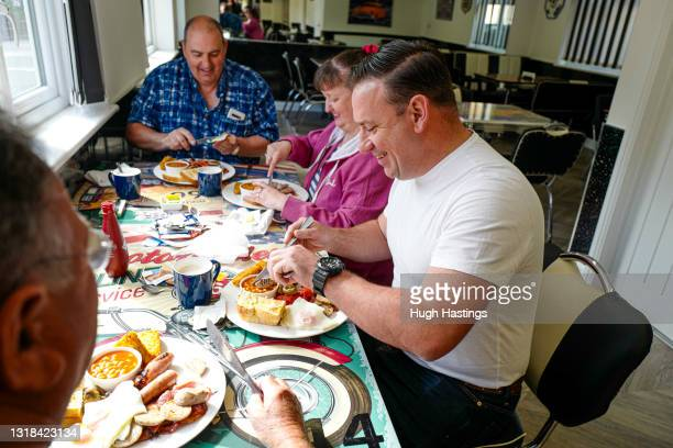 Table of customers are served full English Breakfasts at an indoor table at Jenn's Diner, Redruth, on May 17, 2021 in Falmouth, England. England...