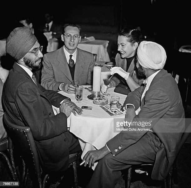 Table of diners--including a pair of Sikhs--enjoy the atmosphere at the swanky Mocambo nightclub on the Sunset Strip on January 5 in Hollywood,...