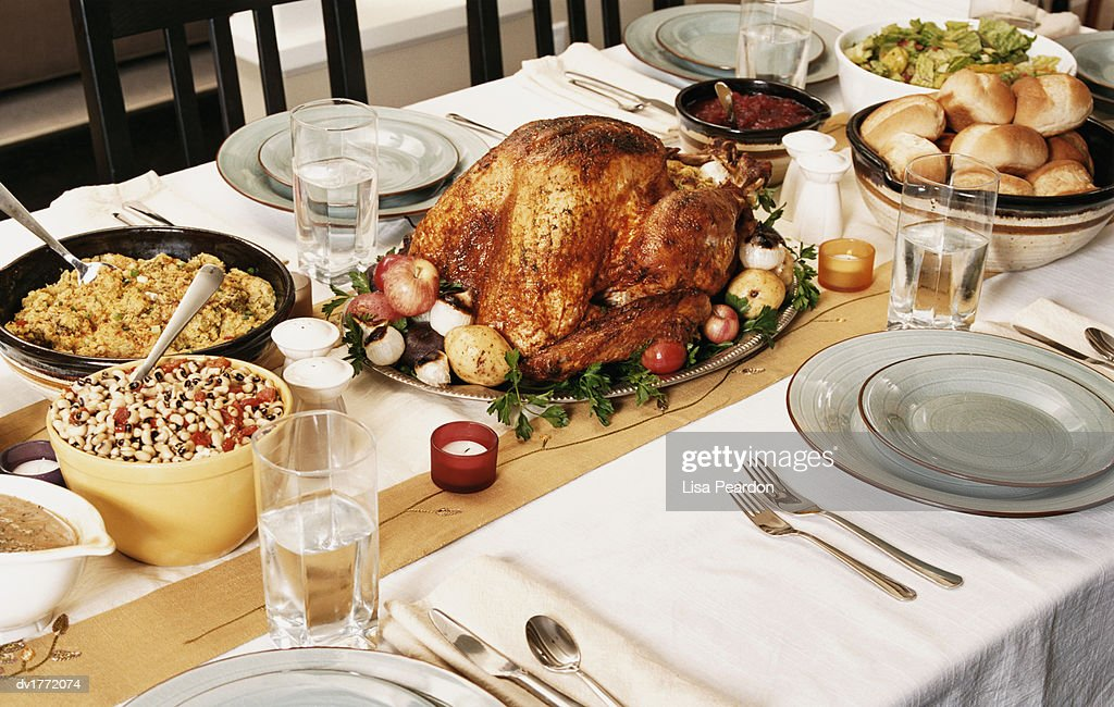 Table of Food Set in Preparation for a Thanksgiving Dinner  Stock Photo & Table Of Food Set In Preparation For A Thanksgiving Dinner Stock ...