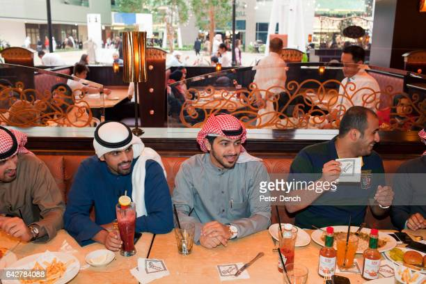 A table of traditionally dressed male friends have lunch at the Cheesecake Factory The Cheesecake Factory in the Mall of the Avenues opened in...