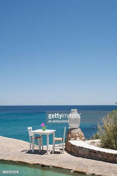 table on balcony overlooking seascape - ver a hora stockfoto's en -beelden