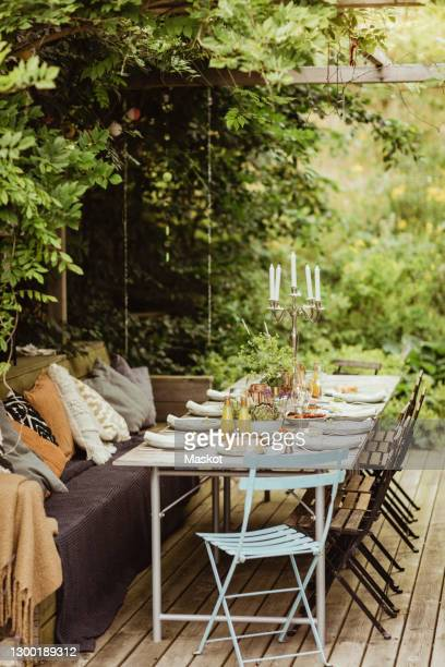 table ready for dinner party at back yard - seat stock pictures, royalty-free photos & images