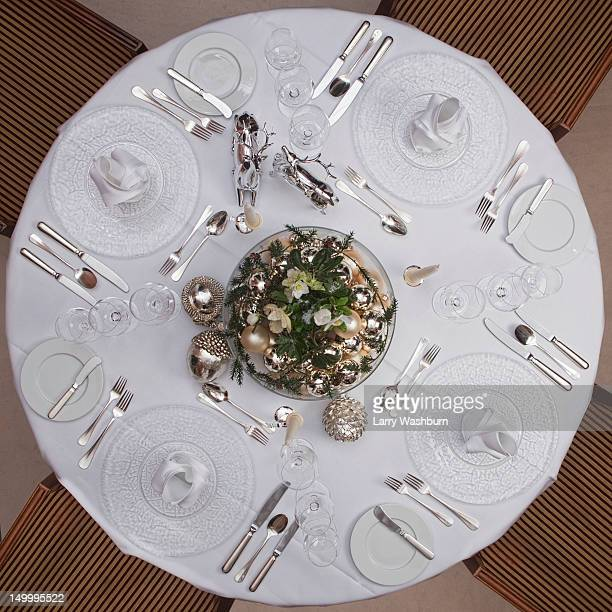 A table set for a formal dinner for four
