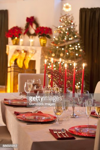 Table Set For Christmas Dinner With Fire Place Stock Photo | Getty Images
