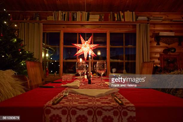 Table set for Christmas in log cabin at night