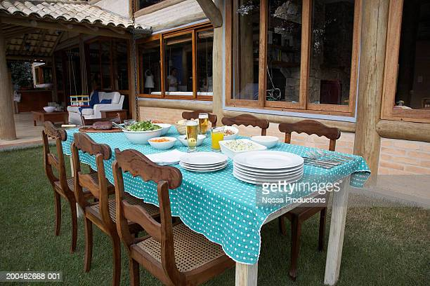 Table set for dinner on lawn