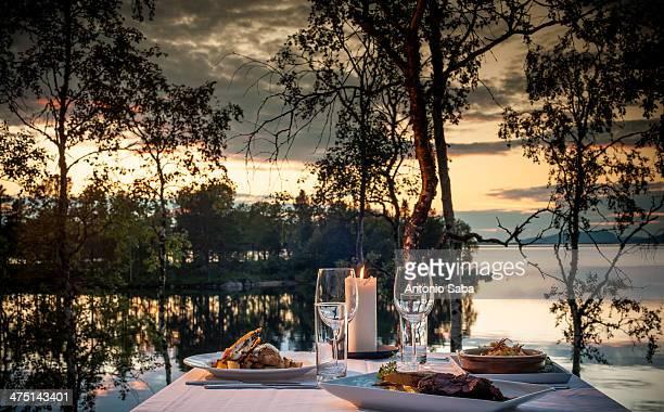 Table set for dinner outdoors, Arjeplog, Lapland, Sweden