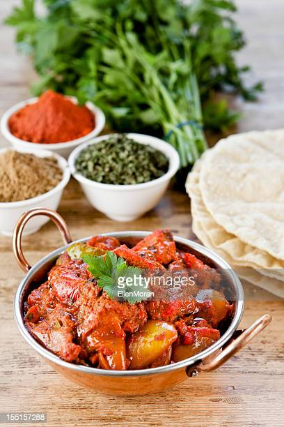 table set for dinner with indian curry - indian food stock photos and pictures
