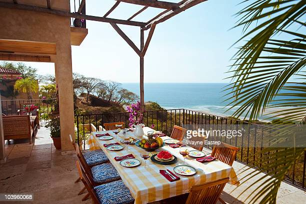 table set for meal on patio, pacific ocean view - guanacaste fotografías e imágenes de stock
