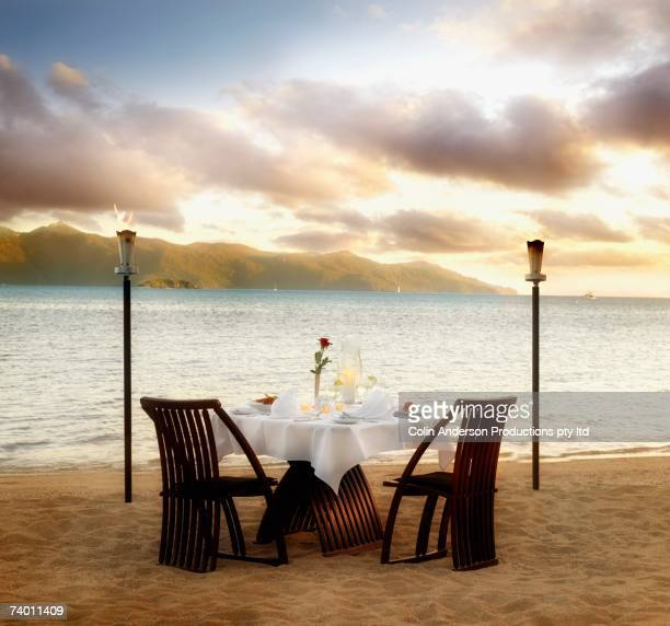 Table set for two at beach