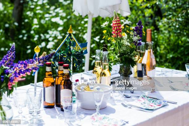 table set in garden - midsommar stock pictures, royalty-free photos & images