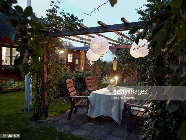 table set in garden - patio stock pictures, royalty-free photos & images