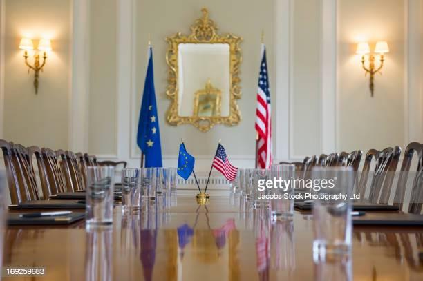 Table set in ornate meeting room