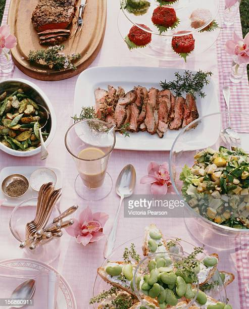 Table set with food platters for a dinner party.
