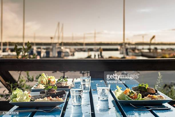 Table set with meals by marina, Reykjavik, Iceland